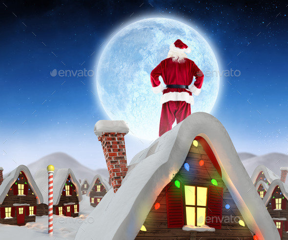 Santa Claus Against Cute Christmas Village In Snow Stock Photo By Wavebreakmedia