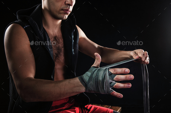 The hands of muscular man with bandage Stock Photo by master1305 ...