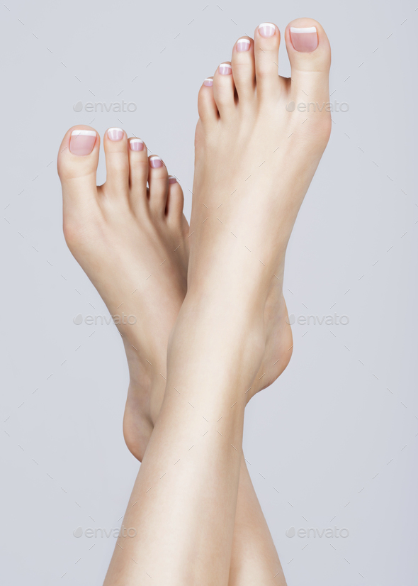 female feet with white french pedicure on nails. at spa salon Stock ...