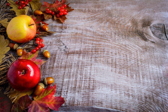 Border Of Apples Red Berries And Fall Leaves On The Rustic Wood