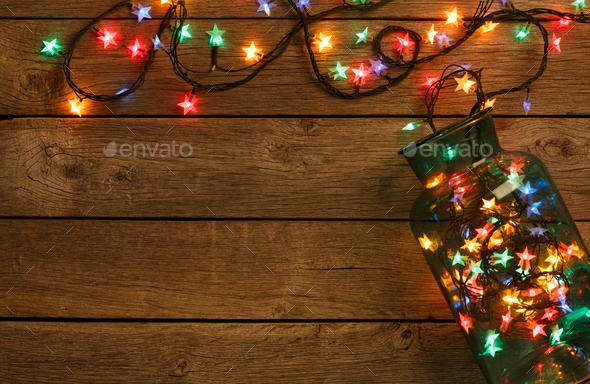 Christmas Lights Border On Wood Background Stock Photo By Prostock Studio