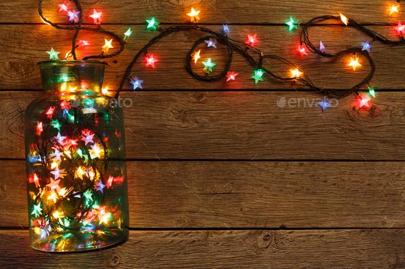 christmas lights border on wood background stock photo images