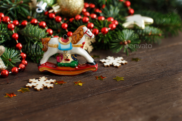 festive decorations with rocking horse and christmas decoration stock photo by katrinshine