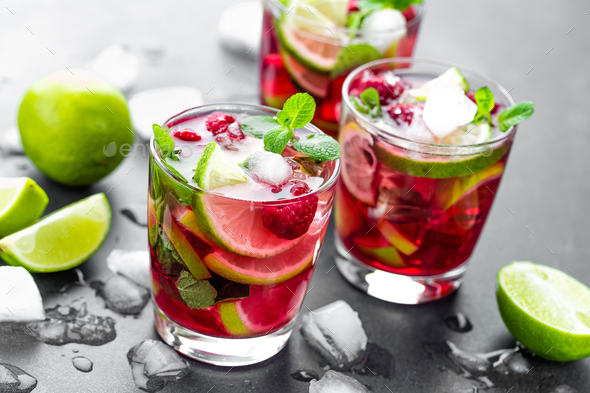 raspberry mojito cocktail with lime mint and ice cold iced