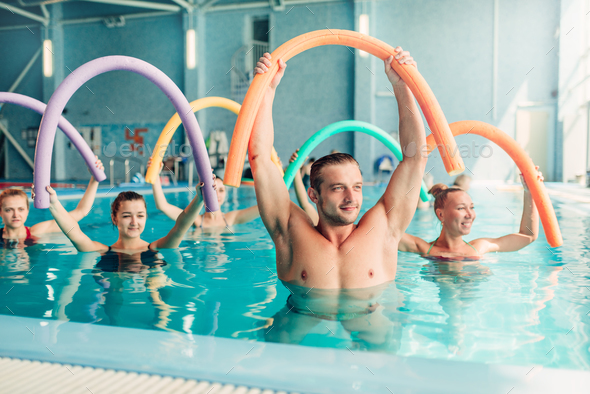 aqua aerobics exercises women with male trainer stock photo by