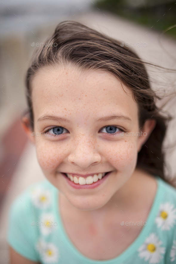 beautiful little girl with blue eyes and freckles Stock Photo by wollwerth