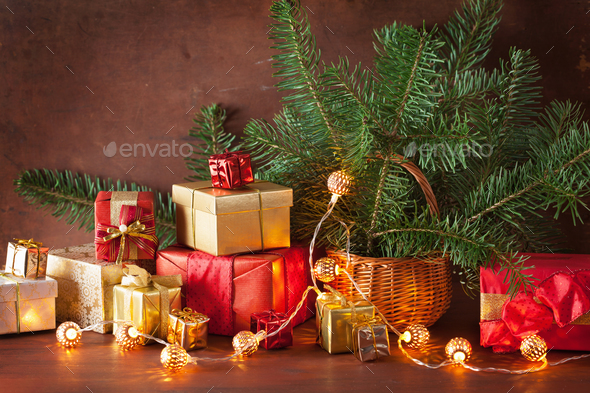 red and golden christmas gift box and decoration lantern candle stock photo by duskbabe