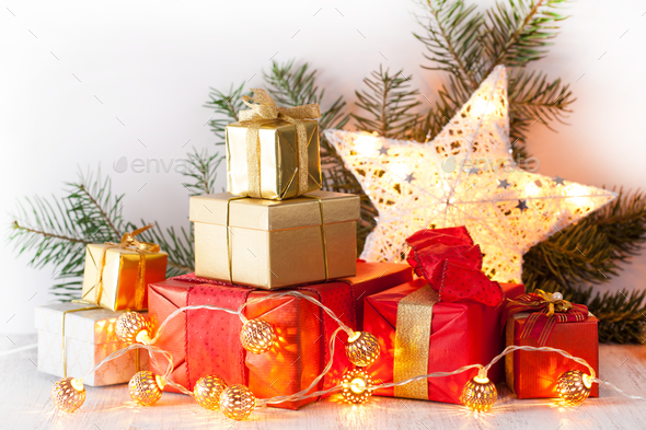 red and golden christmas gift box and decoration light stock photo by duskbabe