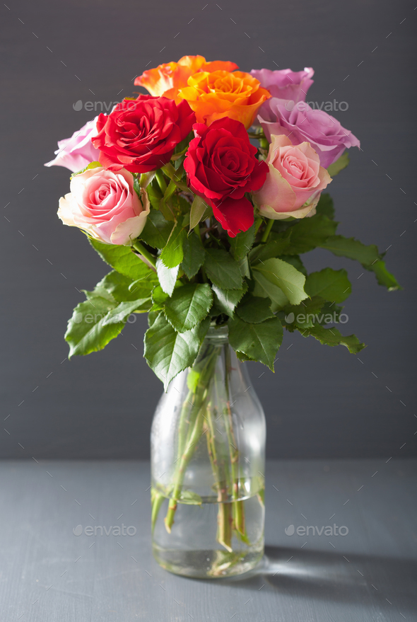 beautiful colorful rose flowers bouquet in vase Stock Photo by duskbabe