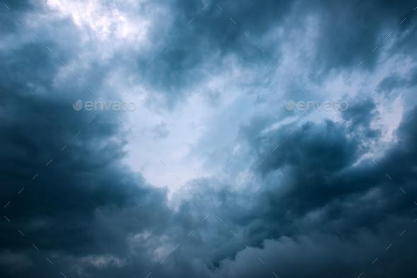 under the rainy clouds stock photo by stevanovicigor photodune