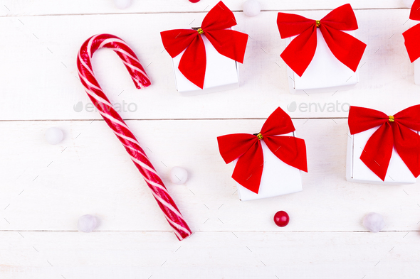 Christmas gifts, white little boxes with red bow and candies on ...