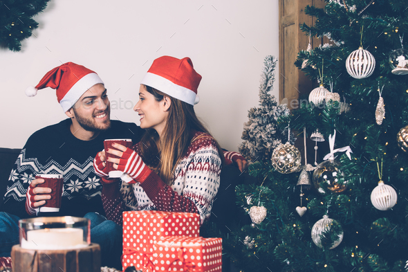 couple having good time on christmas stock photo images