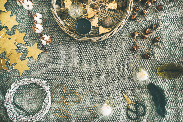 flat lay of christmas toys garlands lights wreath over grey blanket stock photo by sonyakamoz