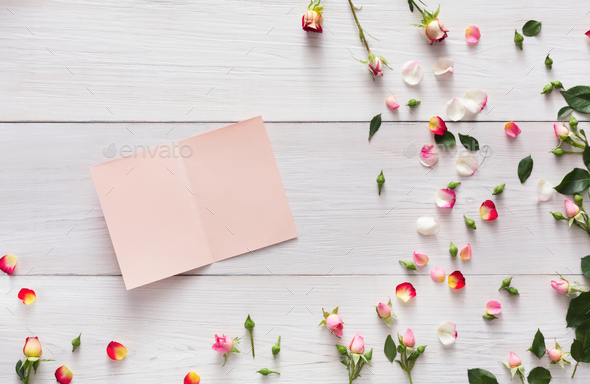 Valentine Background With Scattered Pink Rose Flowers And Petals On White Rustic Wood