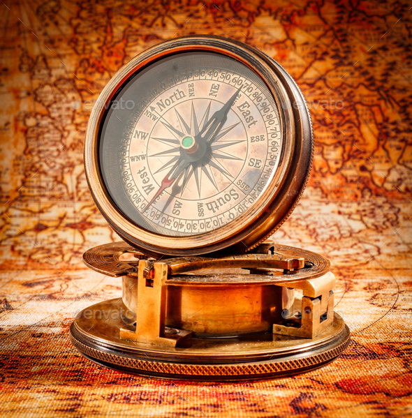 Vintage compass lies on an ancient world map stock photo by cookelma gumiabroncs Gallery