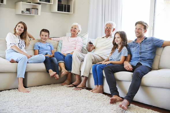 Great Multi Generation Family Sitting On Sofa At Home Watching TV   Stock Photo    Images