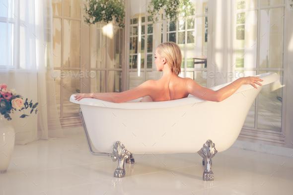 Girl cum sexy woman in bath foot