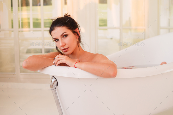 Beautiful Young Sexy Girl With Dark Hair In Bathtub   Stock Photo   Images