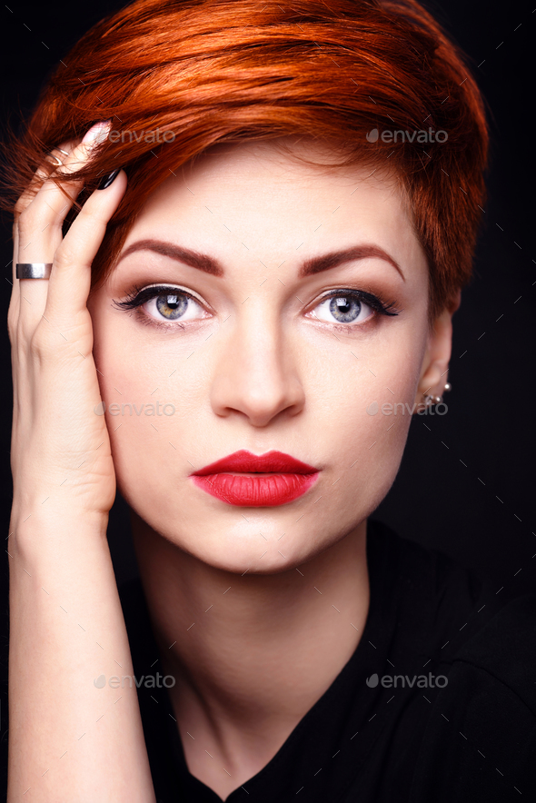 Portrait Of A Beautiful Young Red Haired Woman With Short Hair O