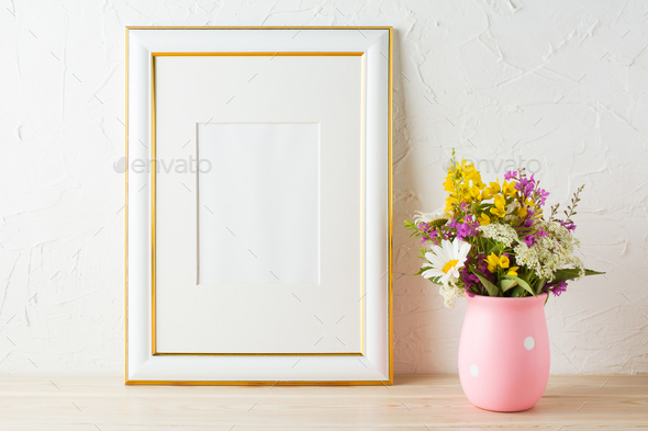 Gold decorated frame mockup with wildflowers in pink vase Stock ...