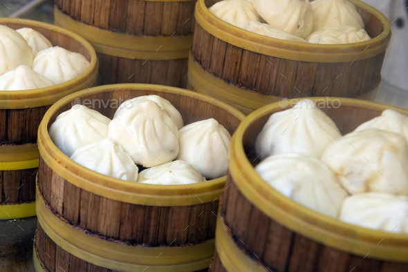chinese style bun in wooden steamer stock photo by kenishirotie