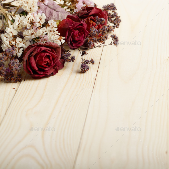 Bouquet of dry flowers and roses on wooden table. Place for text ...