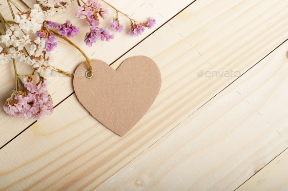 Hand Crafted Paper Tag In Shape Of Heart With Flowers On Wooden