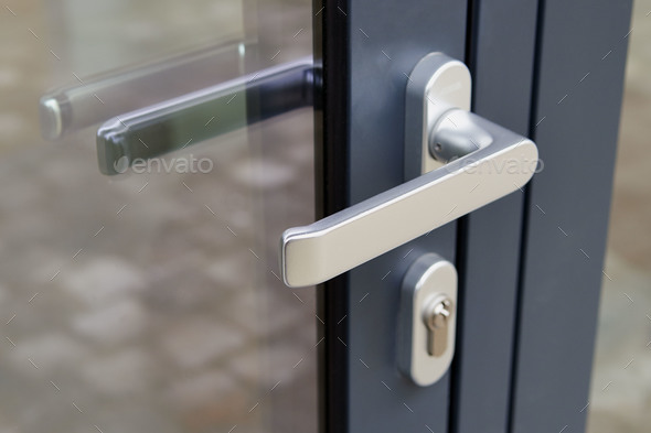 Exterior Door Handle And Security Lock Stock Photo By Pbombaert