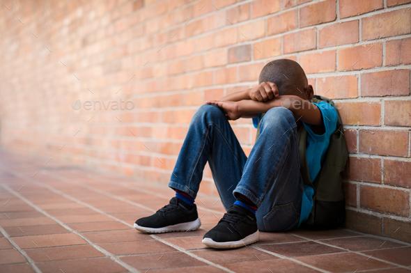 young sad boy at school stock photo by rido81 photodune