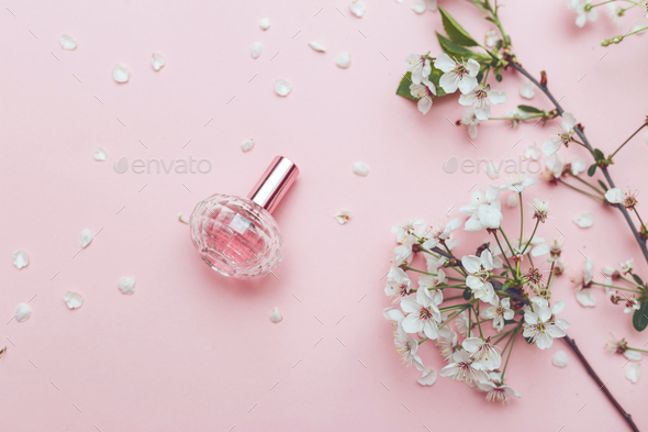 Womens hand spray perfume flower arrangement flowers fragrance womens hand spray perfume flower arrangement flowers fragrance perfume on pink background stock photo by vladdeep mightylinksfo