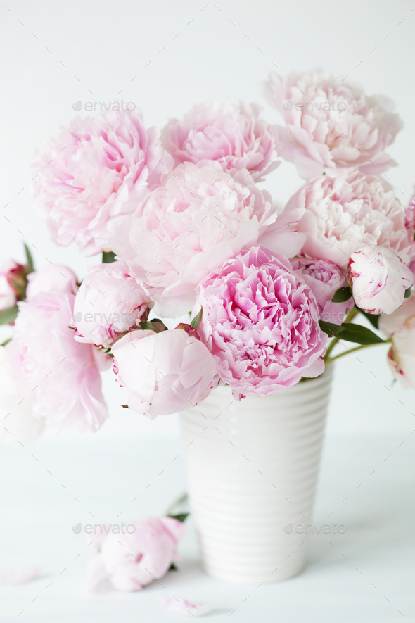 beautiful pink peony flowers bouquet in vase Stock Photo by duskbabe