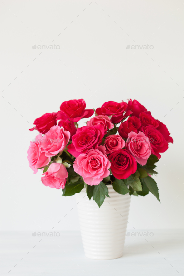 beautiful red rose flowers bouquet in vase over white Stock Photo by ...