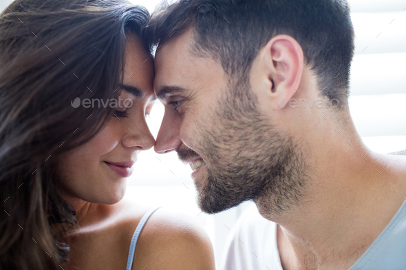 young couple romancing in bedroom stock photo by wavebreakmedia