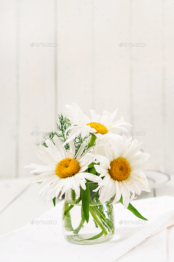 Bouquet Of Daisies In Vase On A Wooden White Table Stock Photo By