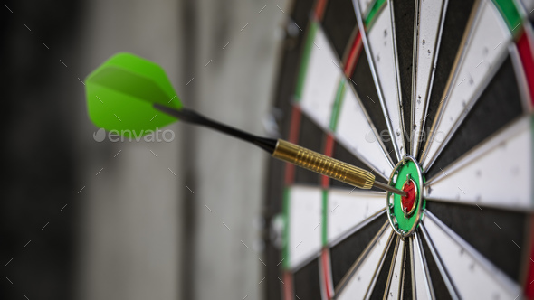 a typical darts game with dart in the bullseye stock photo by markusgann