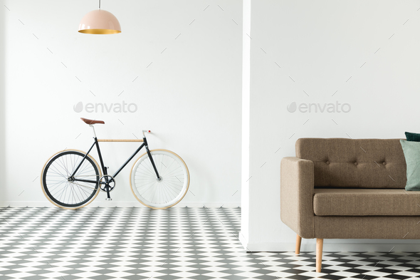 Bike Against An Empty Wall, Cropped Sofa And Checkered Floor In Stock Photo  By Bialasiewicz