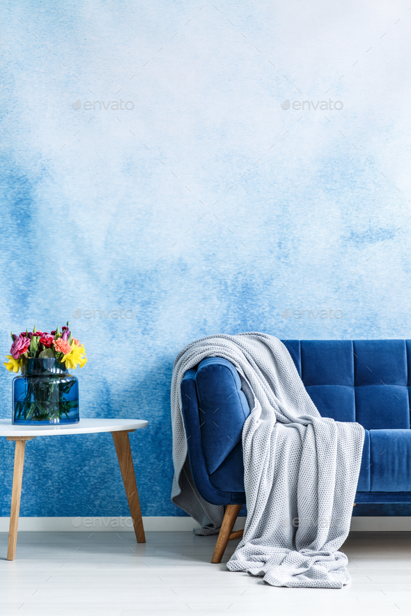 Comfortable Dark Blue Settee With Gray Blanket And Small Side Ta Stock  Photo By Bialasiewicz