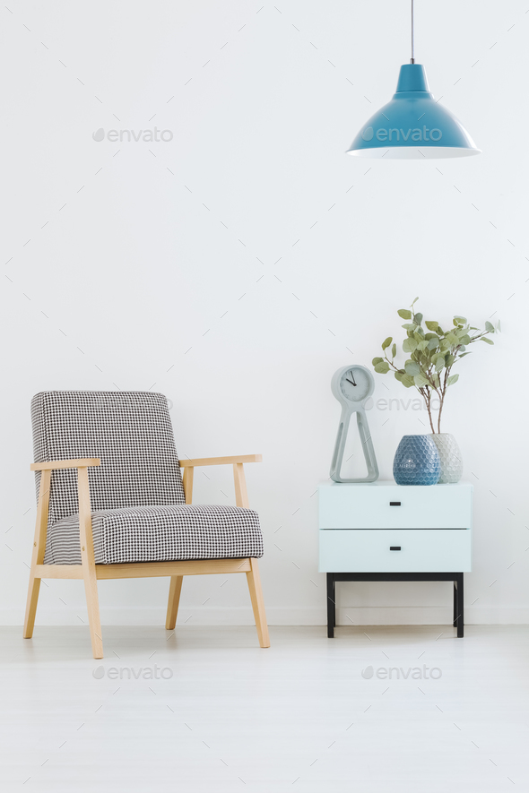 Patterned Armchair Standing Next To Small Cupboard With Clock An Adorable Patterned Armchair