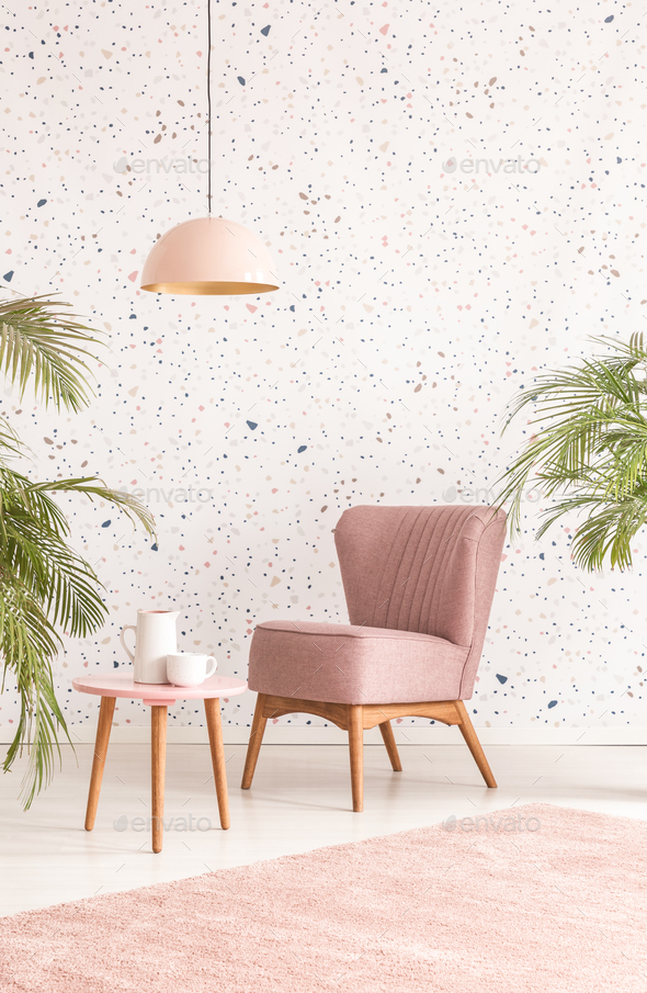 Pink Lamp Above Wooden Table And Armchair In Pastel Living Room Stock Photo  By Bialasiewicz