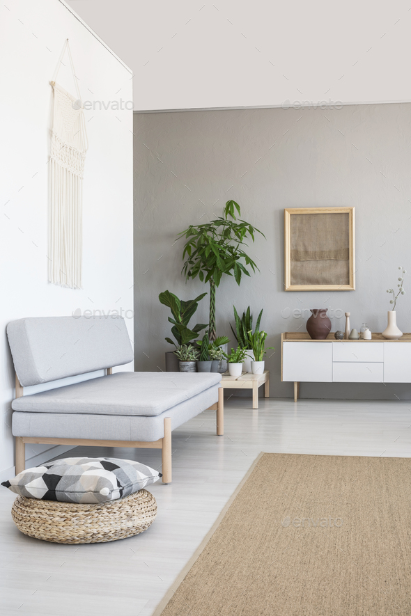 Pillow On Pouf Next To Grey Couch In Scandi Living Room Interior Stock  Photo By Bialasiewicz