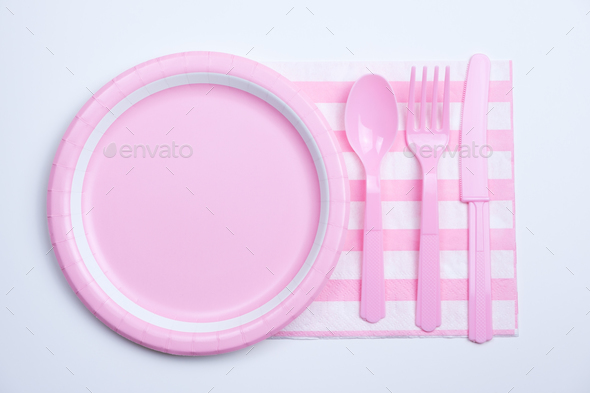 Pink color paper plate with plastic spoon, fork and knife Stock ...