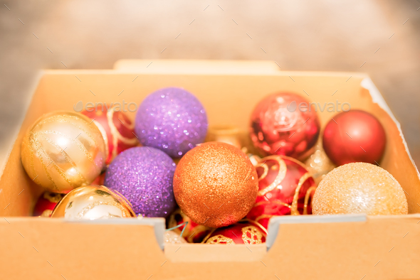 colorful christmas decorations in a cardboard box stock photo by pawopa3336 - Cardboard Box Christmas Decorations