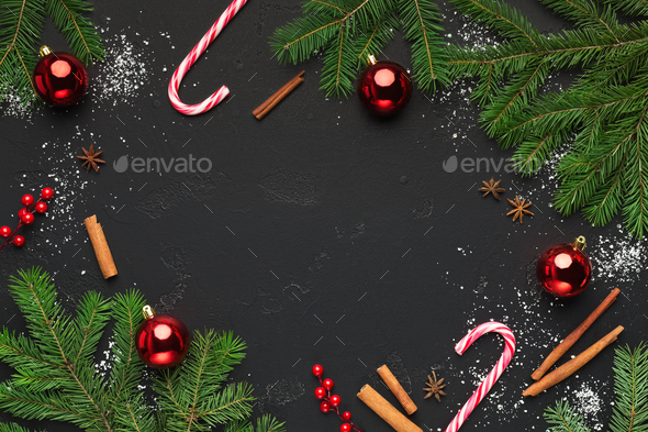christmas background with christmas tree branches and candies stock photo by prostock studio