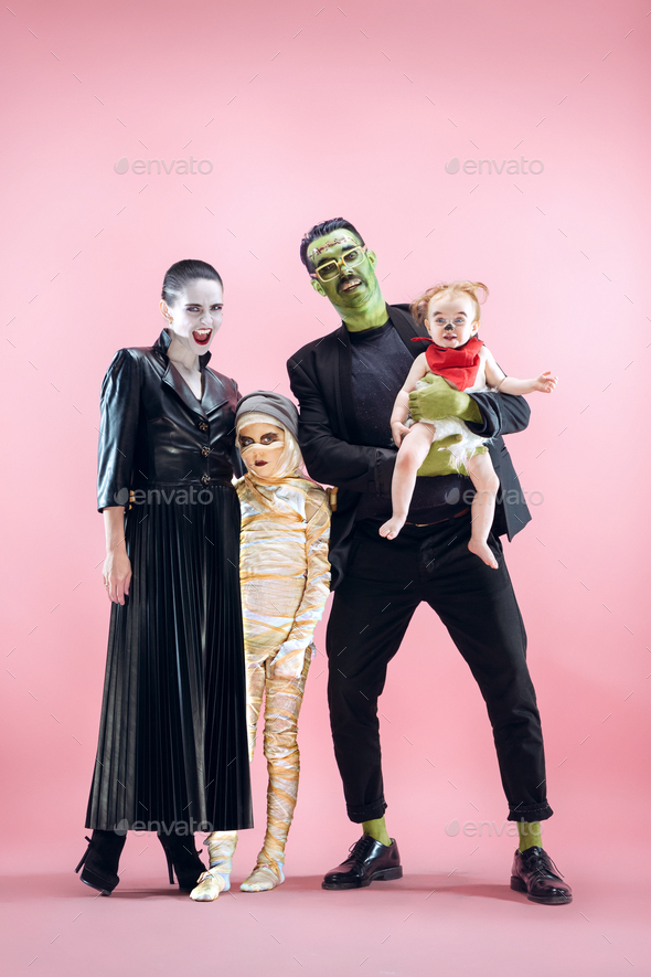 halloween family happy father mother and children girls in halloween costume and makeup stock photo by master1305