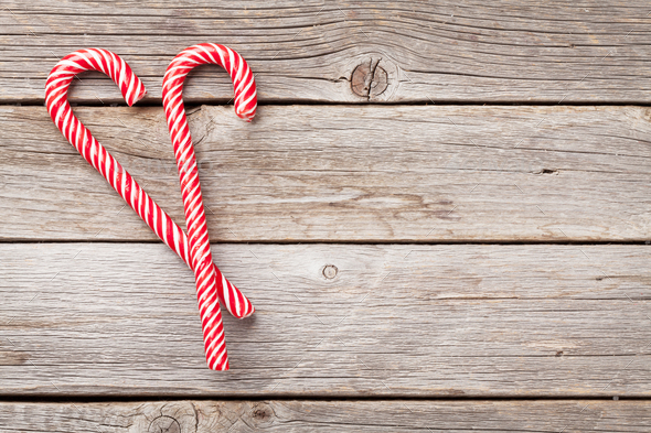 christmas candy canes on wood - Christmas Candy Canes