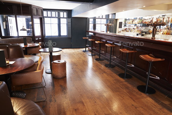 interior of empty bar with stools and counter stock photo by