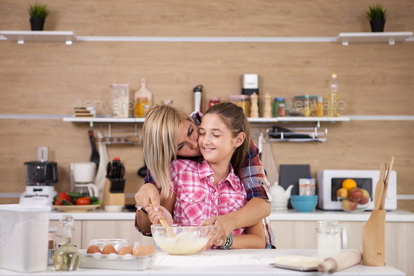 mother with her daughter cooking in the kitchen stock photo images - Cooking In The Kitchen