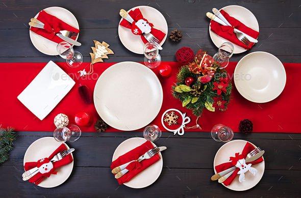 prepared christmas table for serving dishes scenery spruce branches tinsel and candles