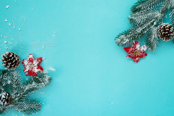 christmas and new year holidays background with snow fir tree and pine cones on blue background stock photo by lyulkamazur
