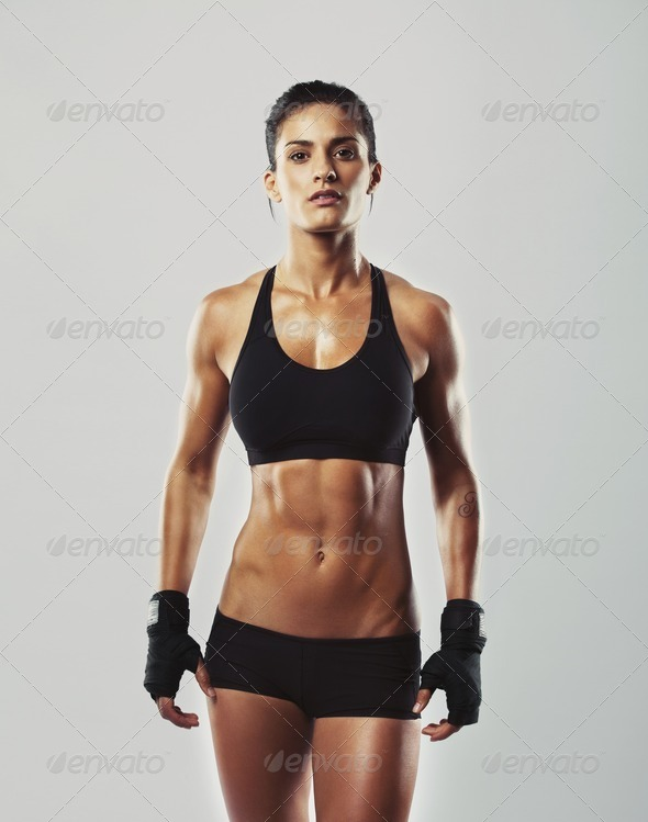 Tough Young Woman With Muscular Body Stock Photo By Jacoblund